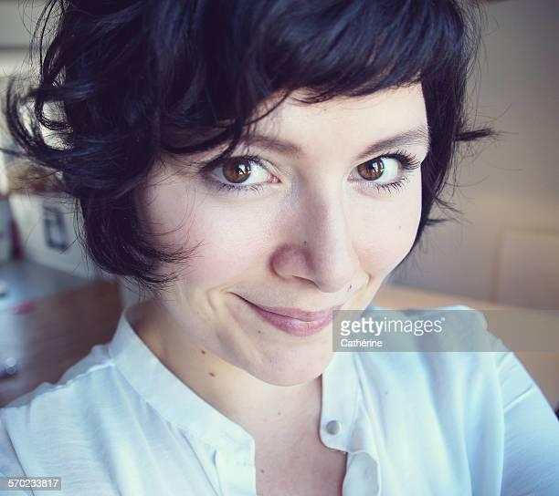 Pretty female with short, curly hair cut