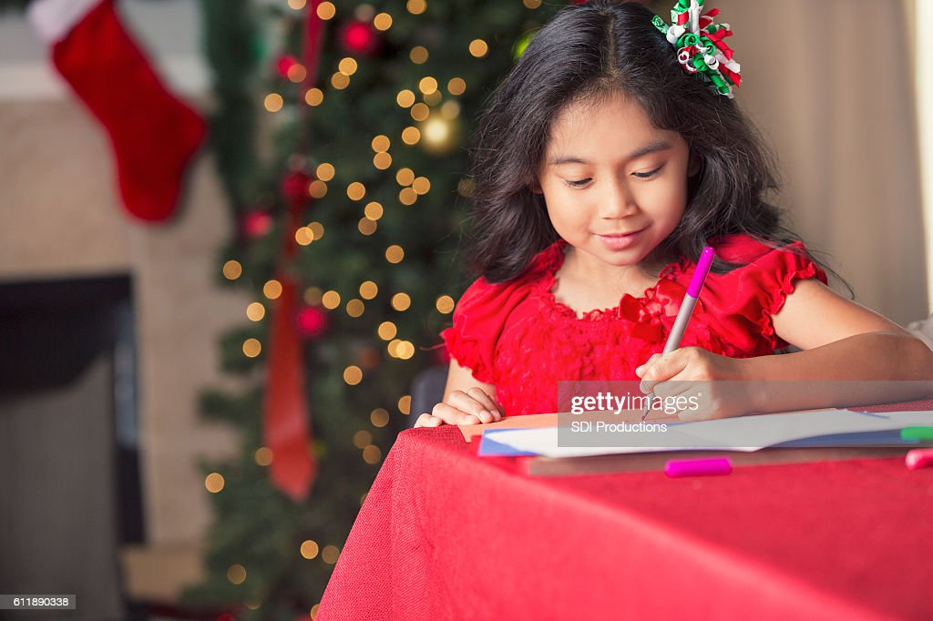 Pretty Filipino Girl Making Christmas Cards For Family Stock Photo