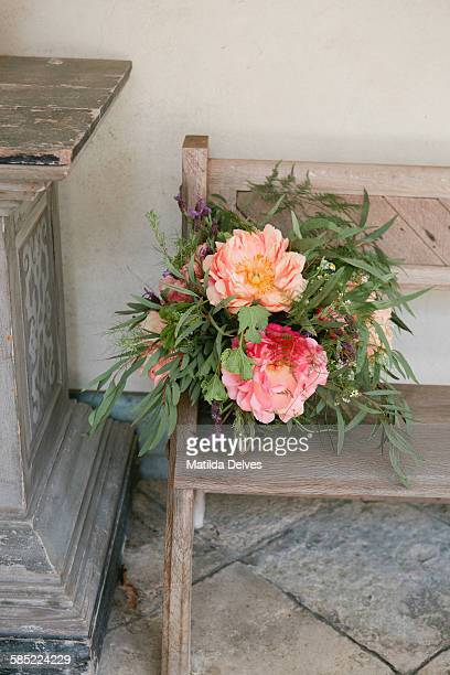 Pretty flower arrangement on a antique bench
