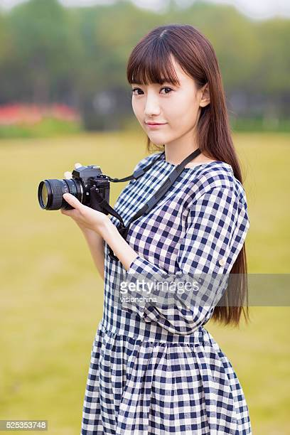 pretty girl dslr camera - beautiful chinese girls stock photos and pictures