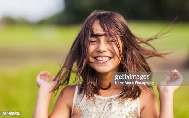 pretty girl enjoying herself. - children only stock pictures, royalty-free photos & images