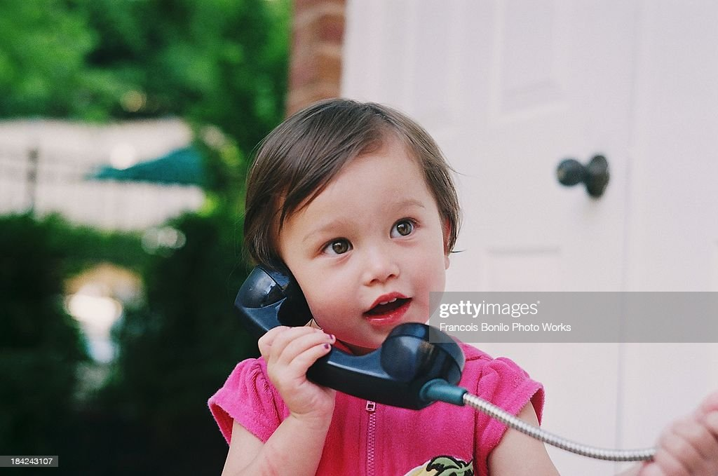 Pretty Girl Making a Call on a Pay Phone : Stock Photo