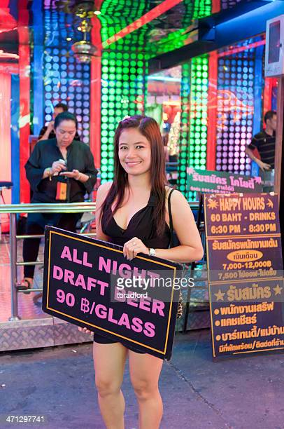 pretty girl outside a gogo bar in bangkok, thailand - thailand prostitutes stock photos and pictures