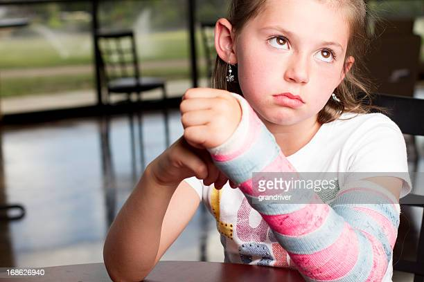 pretty girl with broken arm - cast colors for broken bones stock pictures, royalty-free photos & images
