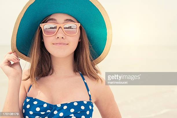 "pretty girl with hat and sunglasses on the beach, copyspace. - ""martine doucet"" or martinedoucet stock pictures, royalty-free photos & images"