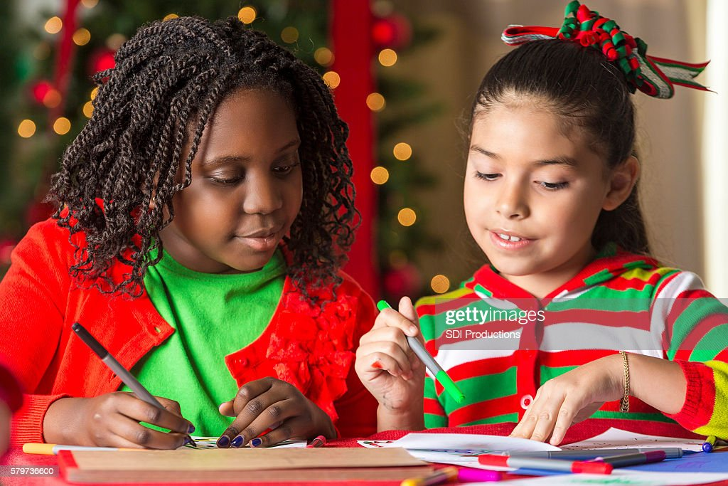 Pretty Girls Making Christmas Cards Together Stock Photo | Getty Images