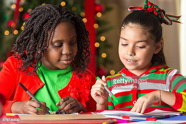 Pretty girls making Christmas cards together
