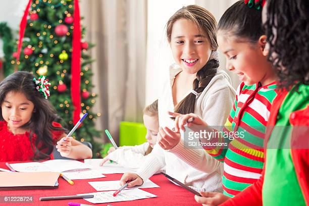 Pretty girls work on Christmas charity project