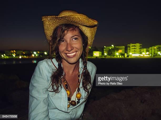 Pretty happy cowgirl at night