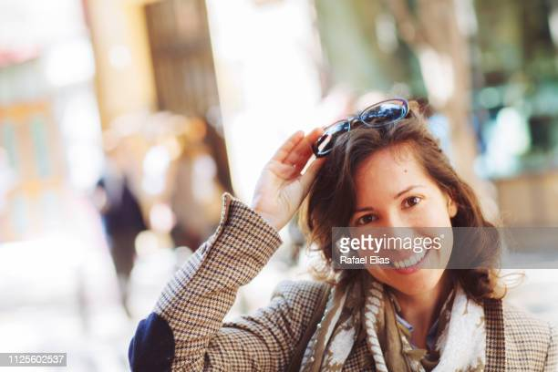 pretty happy woman in the street - no make up stock pictures, royalty-free photos & images