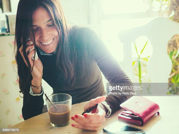 pretty happy woman on the phone - florence douillet photos et images de collection