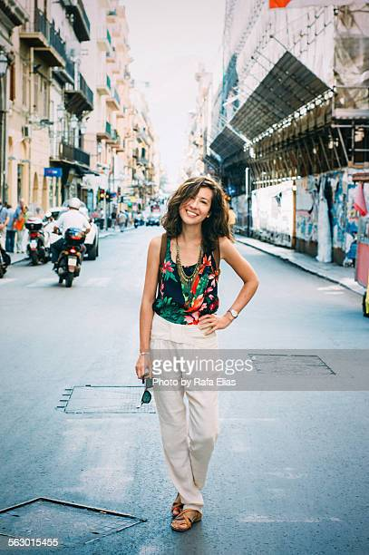 Pretty happy woman standing in the street