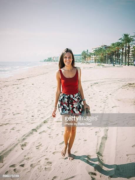 pretty happy woman walking on the beach - leg waxing stock pictures, royalty-free photos & images