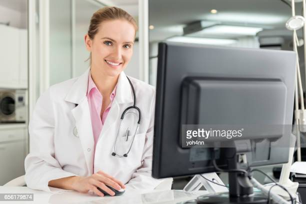 Pretty healthcare worker using computer