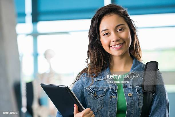 pretty hispanic student in college hallway - cute highschool girls stock photos and pictures