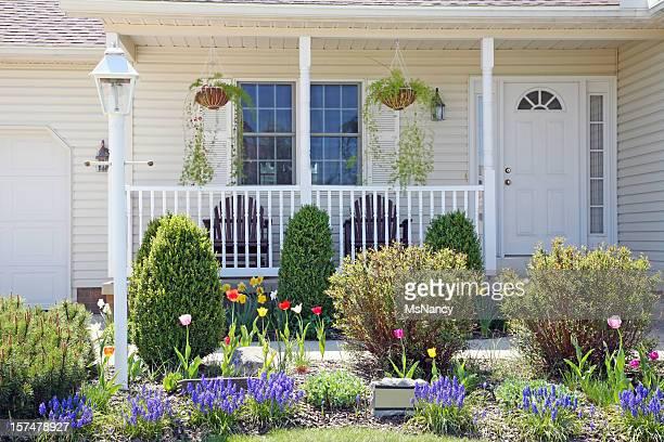 Pretty Home Facade With Spring Landscape