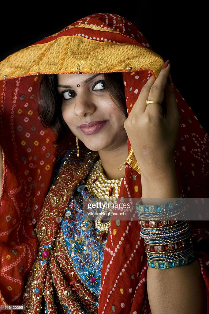 Pretty Indian Woman in colorful traditional clothing : Stock Photo