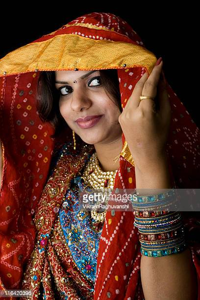 Pretty Indian Woman in colorful traditional clothing