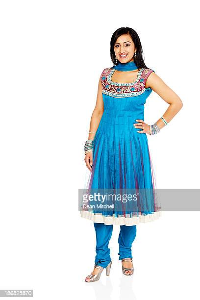 pretty indian woman posing on white background - salwar kameez stock pictures, royalty-free photos & images