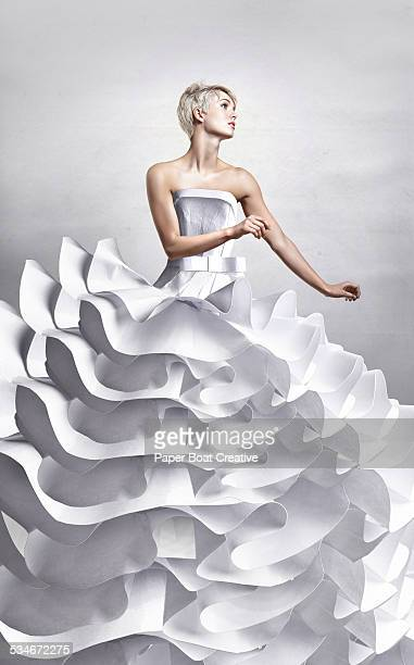 Pretty lady in long white papercraft elegant dress