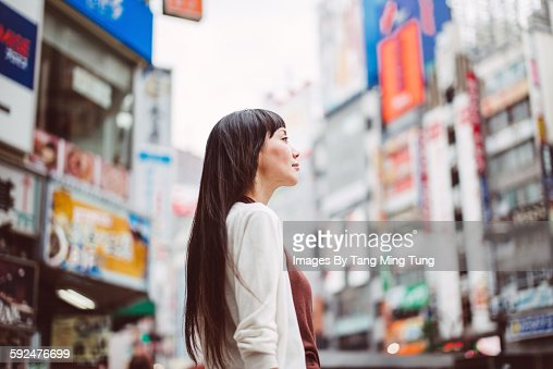 Pretty lady looking at the distance on the street