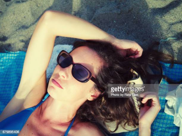 pretty lady suntanning on the beach - armpit hair woman stock pictures, royalty-free photos & images