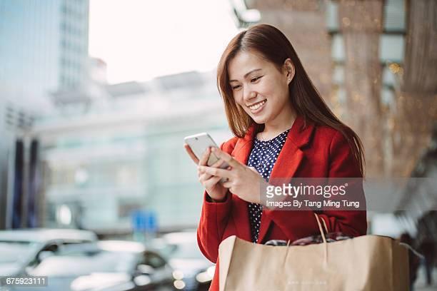 Pretty lady using smartphone in winter.