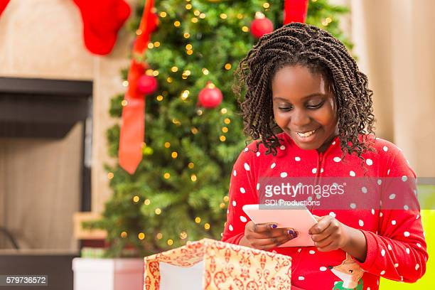 Pretty little girl gets a brand new tablet for Christmas