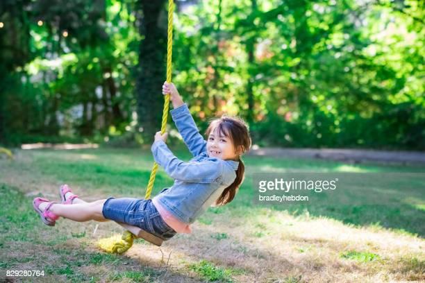 Pretty little girl having fun on zip line in Oregon