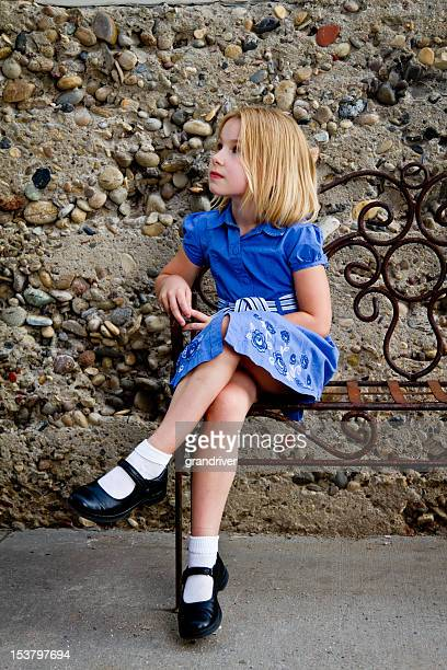 pretty little girl sitting - girls in socks stock photos and pictures