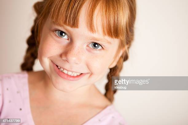 Pretty, Little Girl With Red Hair in Braids