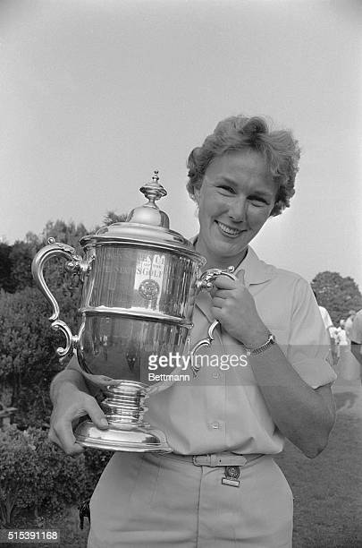 Pretty Mickey Wright 26yearold golfer from Dallas Texas holds trophy after winning US Women's Open Golf Championship here on July 1st This was...
