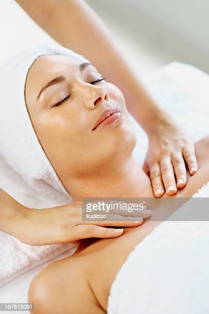 Pretty mid adult lady receiving shoulder massage at spa