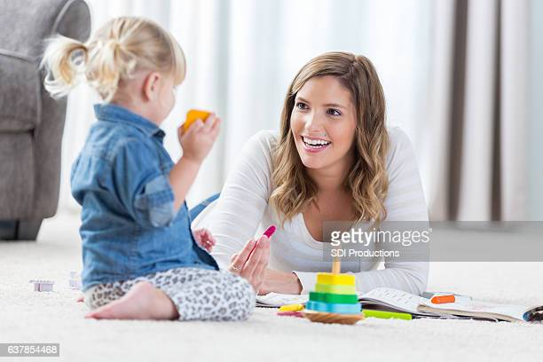 Pretty mother and her preschool age daughter play together