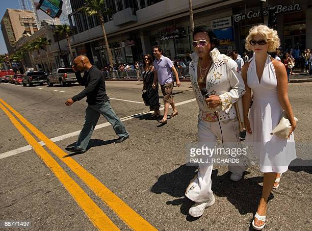 Pretty much like any other day on the Hollywood Walk of Fame celebrity impersonators crosss the street near Grauman�s Chinese Theatre on Hollywood...