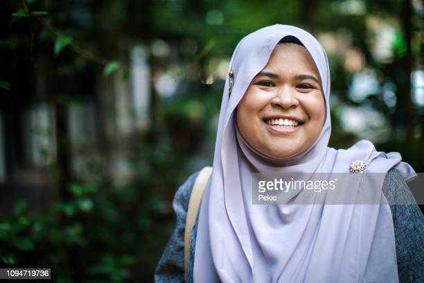 pretty muslim woman - chubby asian woman stock pictures, royalty-free photos & images