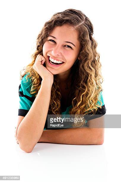 Pretty portrait of smiling young woman resting on elbows. Isolated.