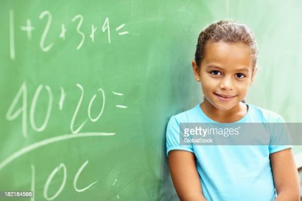Pretty school girl leaning on a board