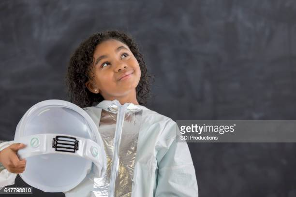 pretty schoolgirl in astronaut costume - astronaut stock pictures, royalty-free photos & images