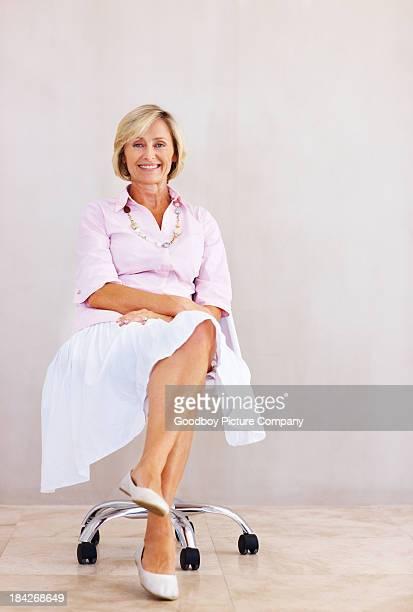 Pretty senior woman relaxing in chair
