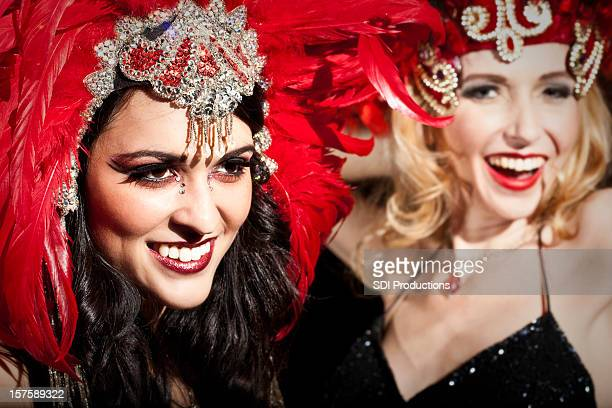 pretty showgirls in red performing on stage - showgirl stock pictures, royalty-free photos & images