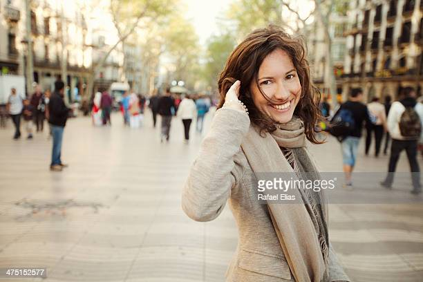 pretty smiling woman in the street - one mid adult woman only stock pictures, royalty-free photos & images