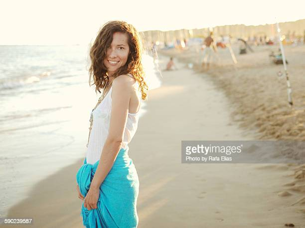 Pretty smiling woman on the shore