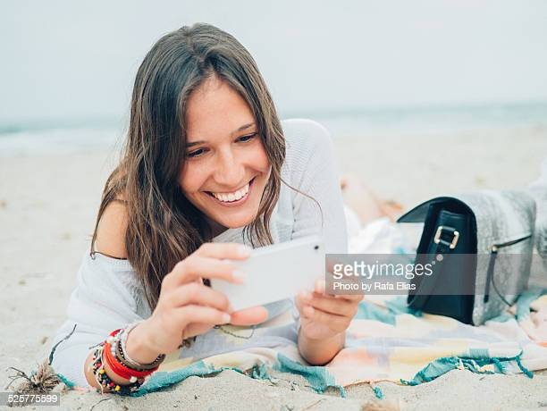 Pretty smiling woman using smartphone