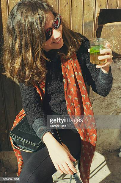 Pretty smiling woman with a mint tea