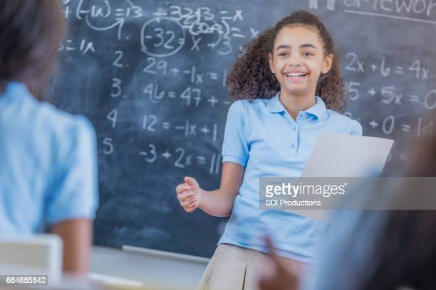 pretty stem student gives oral report in front of class - mathematics stock pictures, royalty-free photos & images