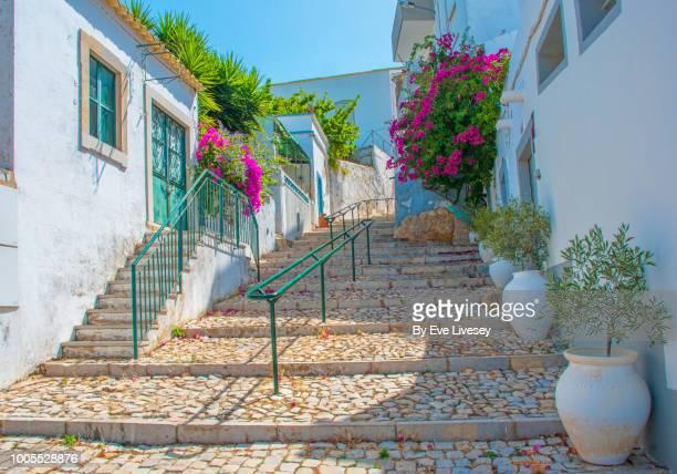 pretty street in estoi - faro city portugal stock photos and pictures