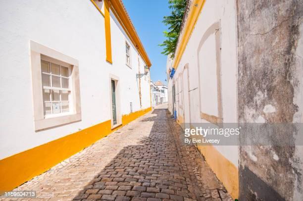 pretty street in faro - faro city portugal stock photos and pictures