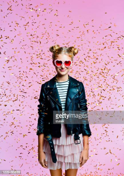 pretty teenege girl among gold confetti - embellished jacket stock pictures, royalty-free photos & images