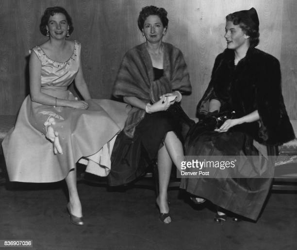 A pretty threesome chatting in the lobby before the opening curtain of 'Gigi' Thursday evening were Miss Diane King Mrs Harold Taft King Miss...